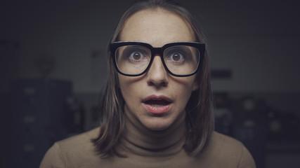 Fototapeta na wymiar Shocked scared woman staring at camera