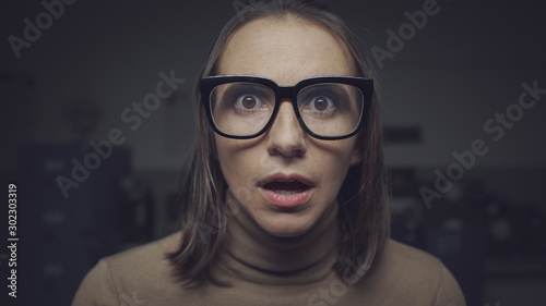Shocked scared woman staring at camera