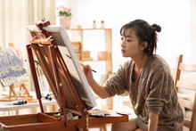 Young Chinese Woman Painting A...