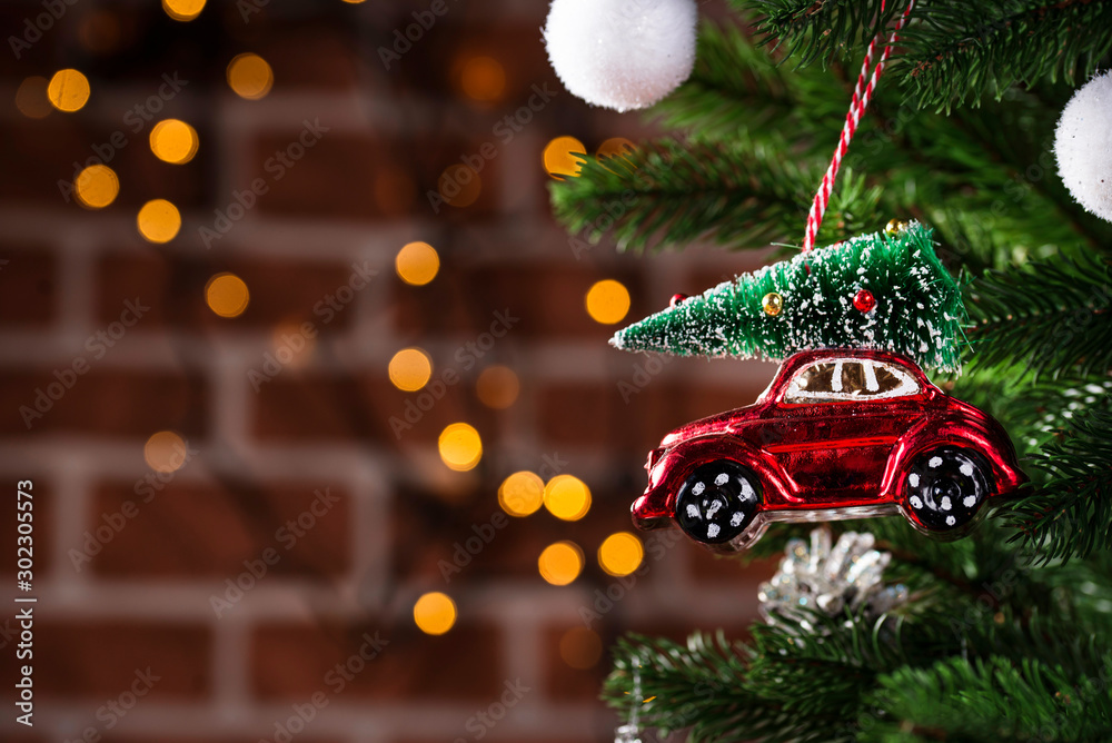 Fototapety, obrazy: Christmas tree toy in shape of red car