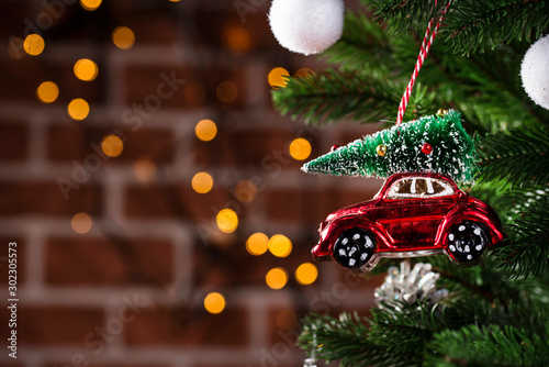 Photo sur Aluminium Vintage voitures Christmas tree toy in shape of red car