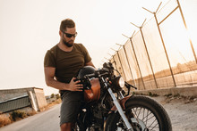 Strong Man Driving Motorcycle