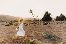 Woman In White Dress In Dry Fi...