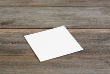 Square Empty White Business Card Template On Wooden Background. Perspective Angle With Soft Shadows. For Branding Identity, Logo Design Pitches And Marketing.