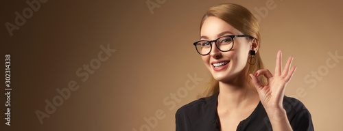 Panoramic portrait of cheerful girl with white healthy teeth smiling and showing Obraz na płótnie