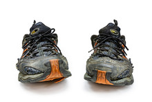 Old Running Shoes On A White Background