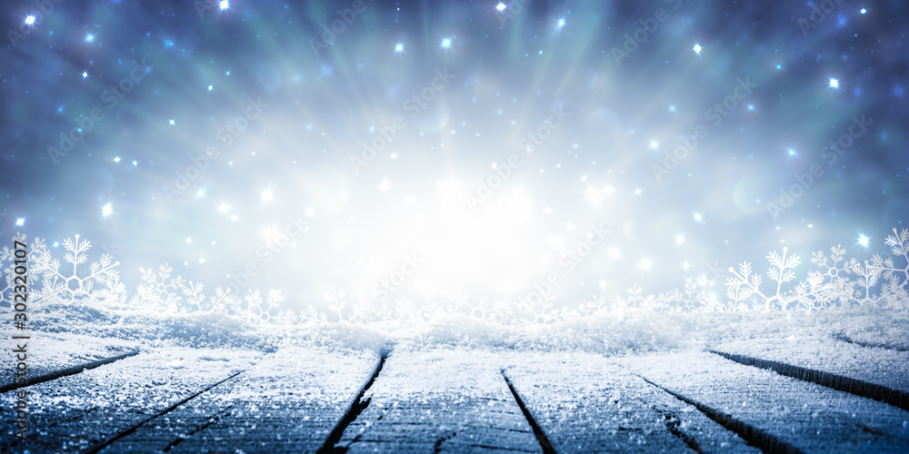 Fototapeta Wooden Plank Table With Sparkling Snow And Brilliant Explosion Background - Winter Display