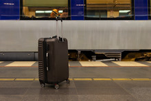 Baggage On Wheels At The Railway Station Near Train. Waiting At Station During Traveling Or Holiday With Luggage