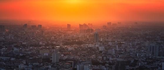 Bangkok District with Glowing Sun at Sunset