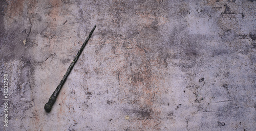 Fotografie, Tablou  magic wand on gray background. Copy space for text