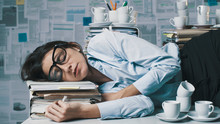 Exhausted Businesswoman Lying ...