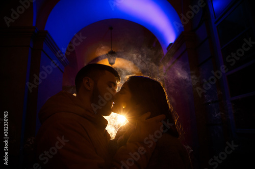 Recess Fitting Dragons Silhouette of a couple in love on a colorful background with steam in cold weather