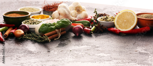 Photo  Spices and herbs on table
