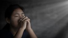 Girl While Praying For Christi...