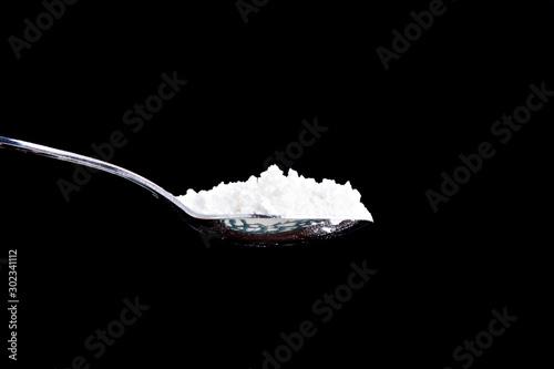 large full spoon of a white powder Fototapeta