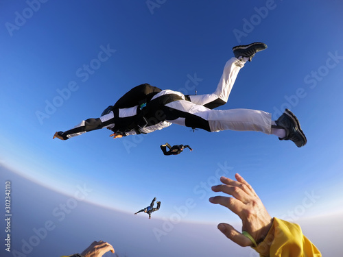 Point of view of a skydiver jumping from the plane. #302342110