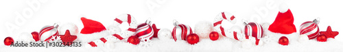 Fotobehang Europa Christmas border of red and white decorations in snow. Side view isolated on a white background.