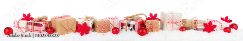 Christmas border of rustic red, white, brown and plaid gift boxes in snow Fototapete