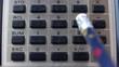 Accountant Using Retro Calculator Pencil Close-up