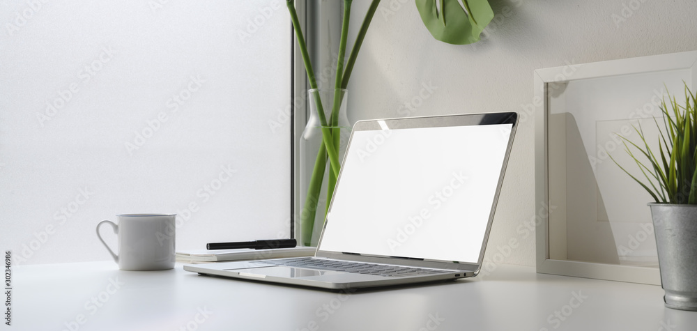Fototapety, obrazy: Close-up view of workplace with blank screen laptop computer and coffee cup