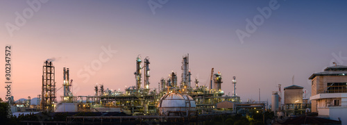 Fototapeta Panorama of Oil and gas refinery plant or petrochemical industry on sky sunset background, Manufacturing of petroleum industrial business obraz