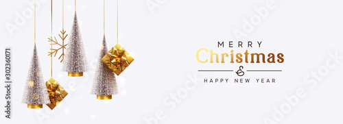 Obraz Christmas banner Background realistic festive gifts box. Christmas lush tree silver color. Xmas present. Horizontal New Year poster, greeting card, header for website. Gold and white decor ornaments - fototapety do salonu