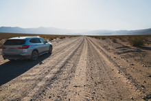Car On Unpaved Road In Desert....