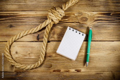 Fotografie, Tablou  Deadly loop of rope and suicide note on a wooden background