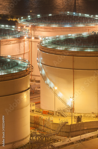 Oil tank storage in factory at night