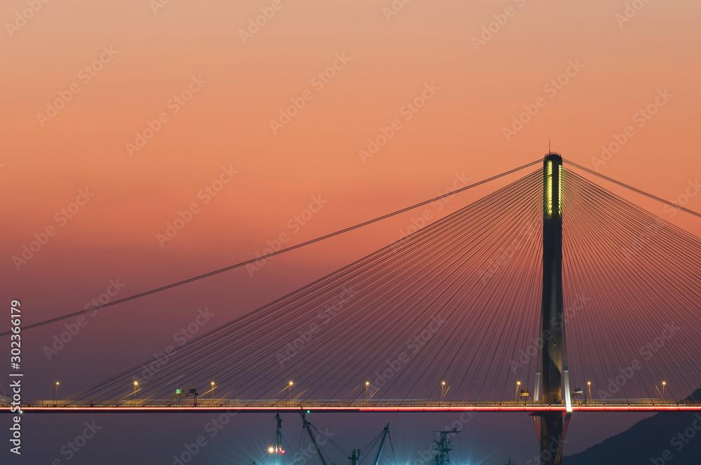 Fototapety, obrazy: Suspension bridge in Hong Kong under sunset