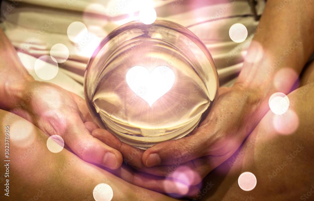 Fotografia Spiritual background: Fortune teller concept, meditation hand with shining heart