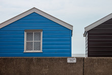 Colorful Sheds On Coast Backgr...