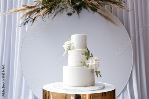 Fototapeta Magnificent bisexual cake for brides and guests obraz