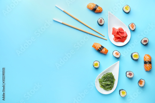 Recess Fitting Sushi bar Composition with tasty sushi on color background