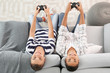 Teenager boys playing video games at home, top view