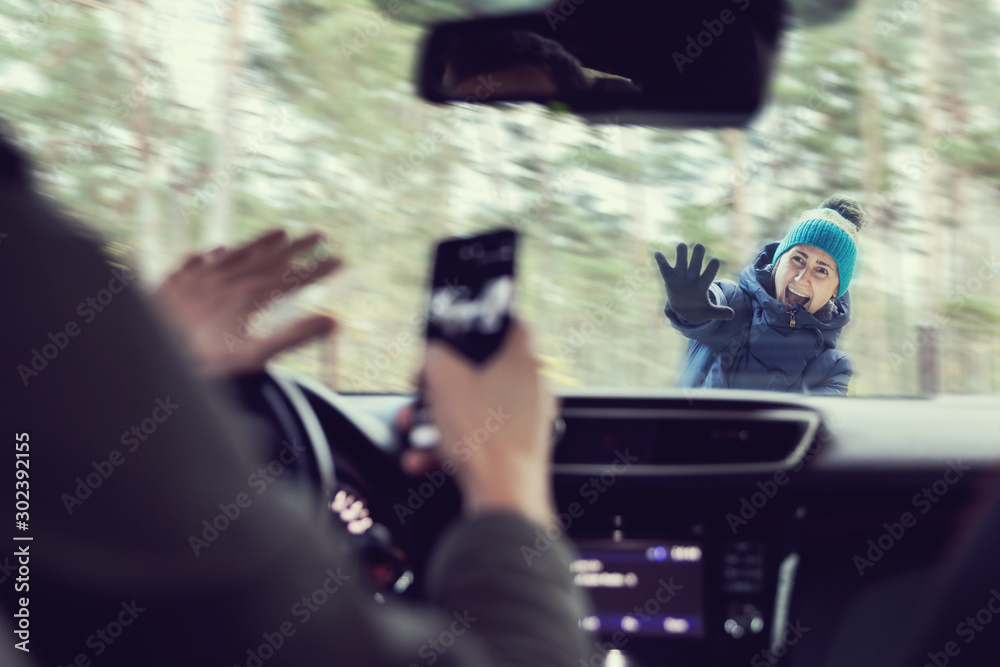 Fototapety, obrazy: pedestrian accident - man using a phone while driving a car