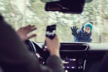 Pedestrian Accident - Man Using A Phone While Driving A Car
