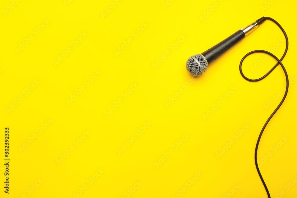 Fototapeta Modern microphone on color background