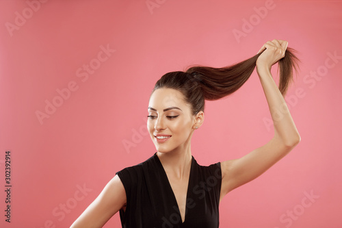 Obraz Portrait of woman with beautiful long hair. Beauty model girl with  brown straight long hair . Care and hair products - fototapety do salonu