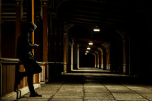 Lonely Man With Smartphone In The Night