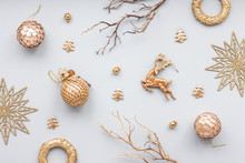 Gold Christmas Decoration On Blue Pastel Background, Top View, Flat Lay