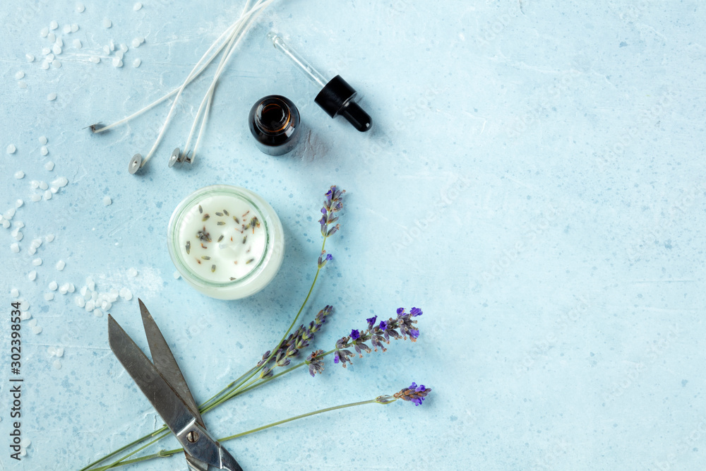 Fototapety, obrazy: Handmade lavender scented candle with essential oil, flowers, wax, wicks, and scissors, flatlay, shot from above with copy space. An artisanal Christmas gift, zero waste Christmas concept, toned image