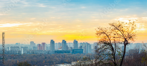 Panorama of Kyiv city and Dnipro river at sunrise in dawn, panoramic view to the colorful autumn cityscape in the morning, Ukraine