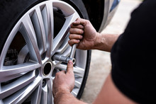 Picture Of A Man Changing Tire...