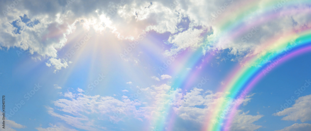 Fototapeta Beautiful vibrant double rainbow Cloudscape Background - awesome blue sky with pretty clouds, bright sun shining down and a large double rainbow arcing across the right corner with copy space - obraz na płótnie