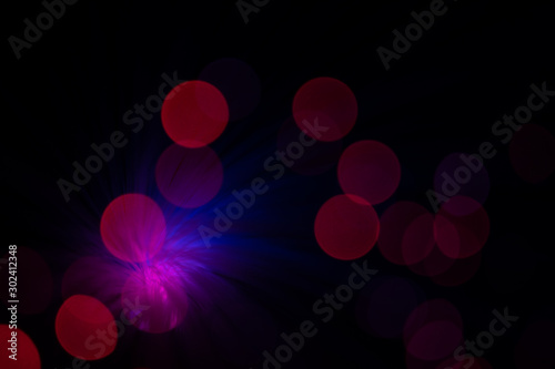 Fotografía  Colorful red, blue and pink lens flares with beautiful bokeh on black background