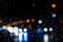 Rainy Night, Rain Drops On The Window And Colorful Traffic Bokeh Light