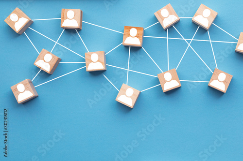 Fotografia  Wooden blocks connected together on a blue background