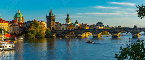 Obraz View of Charles bridge in autumn sunny day. Prague. Czech republic - fototapety do salonu