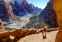 Traveler Hikes Along The Angel's Landing Hiking Path On A Sunny Winter Day.